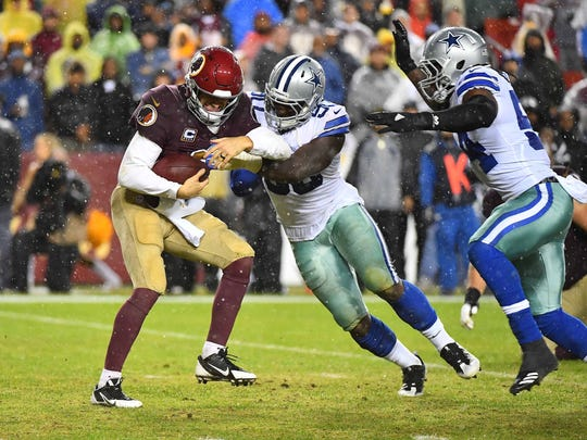 Oct 29, 2017; Landover, MD, USA; Washington Redskins quarterback Kirk Cousins (8) is sacked by Dallas Cowboys defensive end Demarcus Lawrence (90) and outside linebacker Jaylon Smith (54) during the second half at FedEx Field. Mandatory Credit: Brad Mills-USA TODAY Sports