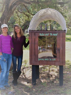 Left to right: Anessa Collins, Jasmyne Rogers and Chuck Wagon pantry delivered to Schoolhouse Park. Collins initiated getting the chuck wagon pantries in Ruidoso. Rogers of Jasmyne's Interiors volunteered to decorate and pant them and her husband, Adam Roger's, company, Chandler Builders, built the wagon tops.