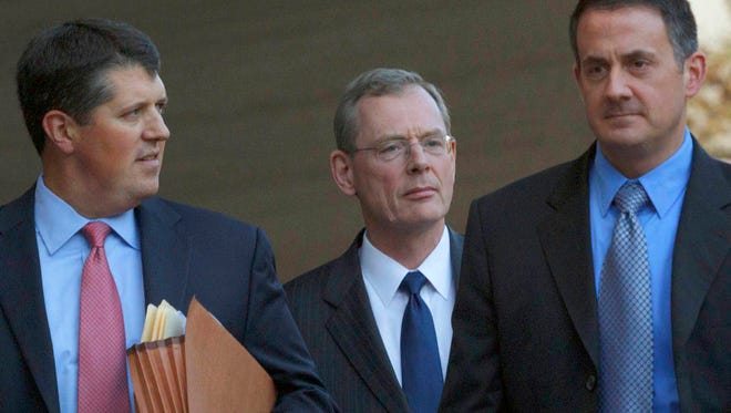 In a Nov. 28, 2012 file photo, David  Rainey, center,a former BP vice president during the Deepwater Horizon oil rig explosion, leaves Federal Court after being arraigned on obstruction of a federal investigation in New Orleans. Jury selection in a federal trial is set to begin Monday, June 1, 2015, in New Orleans for Rainey, who is accused of obstructing a congressional investigation into the 2010 Gulf oil spill. Rainey has pleaded not guilty to charges. (AP Photo/Matthew Hinton, File)