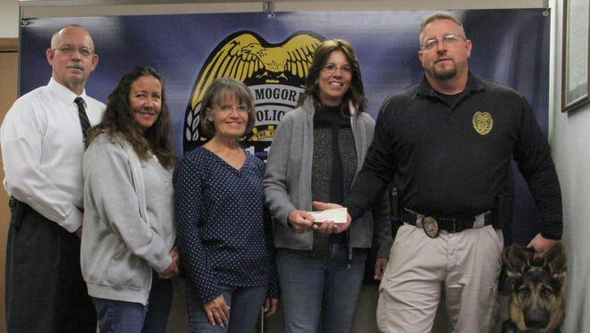The White Sands Agility Club donated $500 to the Alamogordo Police Department K-9 Unit Feb. 14.