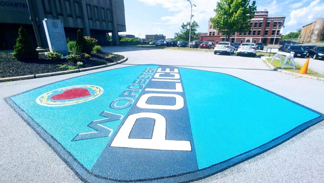 A painting of the Worcester Police Department emblem on the pavement in front of the police station.