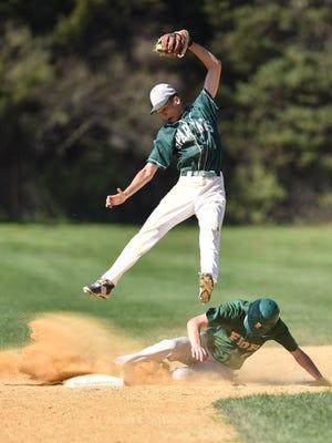 Franklin D. Roosevelt's Kyle Zigner slides into second base under Spackenkill's Josh Rosario during a game in Hyde Park last season.
