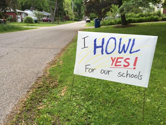 A handmade sign on a lawn on Brewer Parkway in South