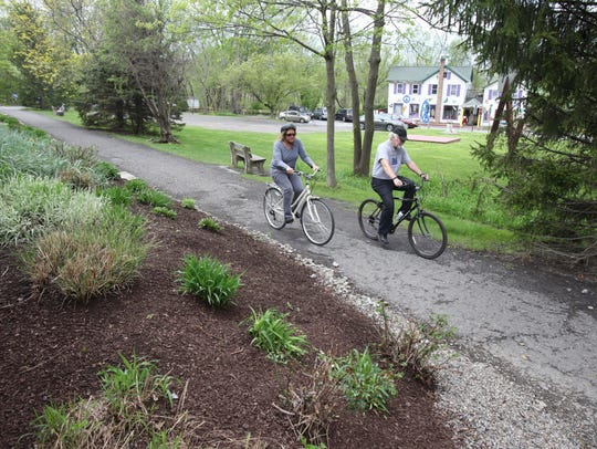 Rael Cantline and John Connolly enjoy a leisurely ride along the Wallkill Valley Rail Trail that runs through the business district in New Paltz.