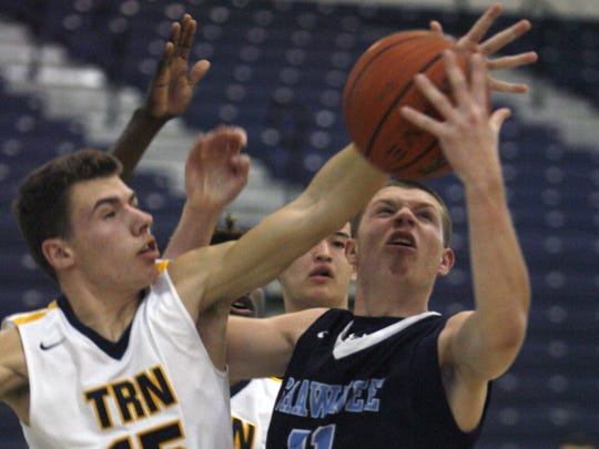 Toms River North's Sean O'Donnell, left, attempts to block a shot by Shawnee's Dean Noll in the South Group IV South final at Toms River North High School March 7, 2017.