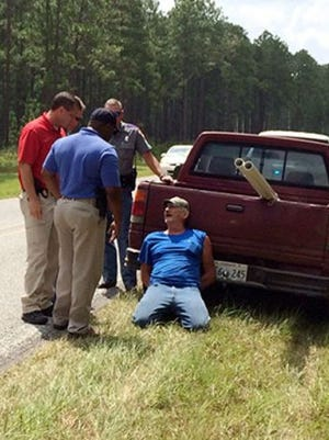 Alfred Baria is questioned after a traffic stop by MBI and MHP.