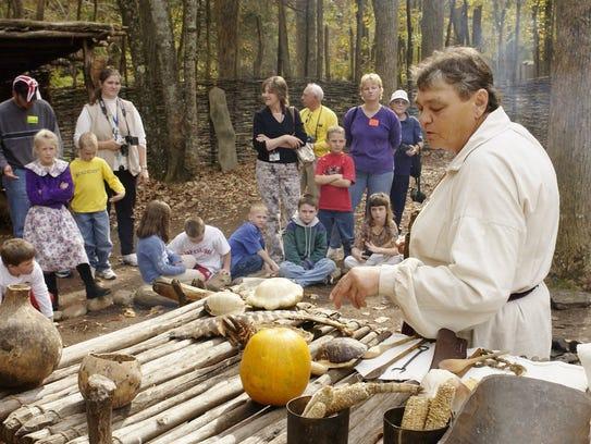 Bertie Branham, a Monacan Indian, explains cooking