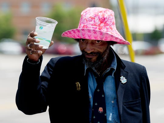 A homeless man thanks the group for the cup of water during the Win Our World (WOW) Urban Ministry program at St. John's Lutheran Church during a water handout along Broadway in Knoxville, Tennessee on Thursday, July 20, 2017. Because temperatures have been so hot, the youth provided water from a large pot to homeless in the mission district a couple of times this week.