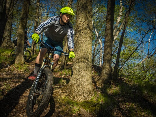 A mountain biker rides through Hixon Forest in La Crosse.