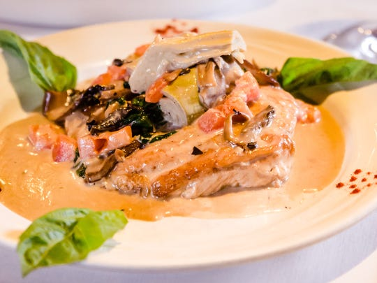 Pollo alla Sonoma at Cafe Fiore in South Lake Tahoe features boneless breast of chicken sautéed with wild mushrooms, artichoke hearts and tomatoes.