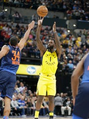 Indiana Pacers guard Lance Stephenson (1) shoots over Oklahoma City Thunder forward Josh Huestis (34) during the second half of an NBA basketball game in Indianapolis, Wednesday, Dec. 13, 2017. The Thunder defeated the Pacers 100-95. (AP Photo/Michael Conroy)