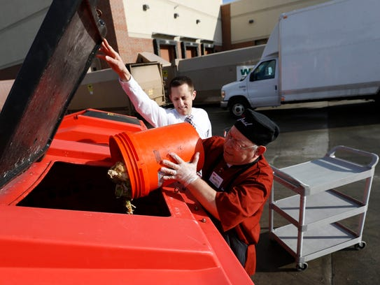 Store operations manager Clint Draheim holds open the