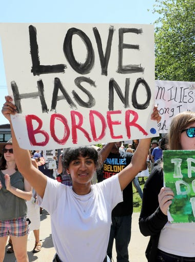 """Dheivanai Moorthy and Francesca Daszak, both from Suffern, attend the """"Families Belong Together"""" rally at the Rockland County Courthouse in New City, June 30, 2018."""