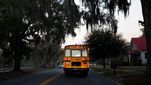 In this Tuesday, Jan. 31, 2017, file photo, a school bus drives through Estill, S.C. The true extent of student-on-student sexual assault in elementary and secondary schools is unclear. There are no national requirements for schools to track and disclose such incidents, as there are for colleges and universities, and sexual violence in general is widely under-reported.