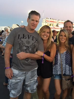 Mark Rosenberg, his wife Traci and their friends Denise Ozoroski and Randy Solomon at the Route 91 Harvest Festival in Las Vegas on Sunday.