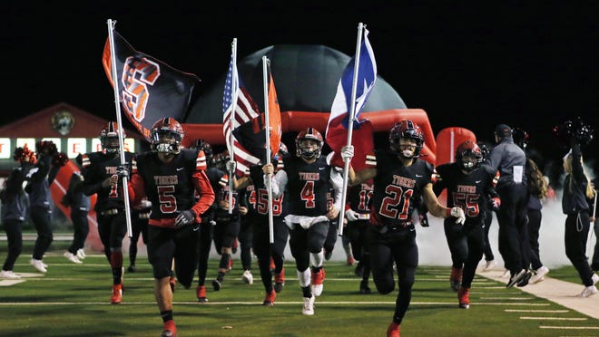 The Slaton football team takes the field prior to a Class 3A Division I bi-district playoff game Nov. 15, 2019 against Brownfield at Tiger Stadium in Slaton. First-year coach Lawrence Johnson is looking to instill discipline in the Tigers.