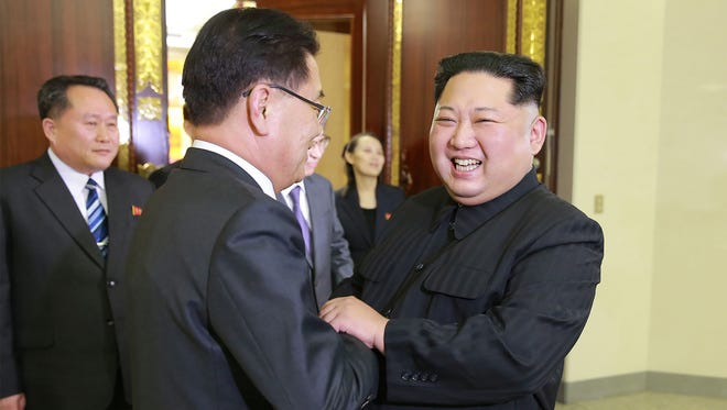 North Korean leader Kim Jong Un, right, shakes hands with Chung Eui-yong, an envoy of South Korean President Moon Jae-in, during their meeting in Pyongyang on Monday.