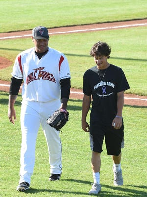 Noah Tavera walks back after throwing the first pitch during a Salem-Keizer Volcanoes game against the Vancouver Canadians on Monday, June 22, at Volcanoes Stadium in Keizer. Tavera's father, Pancho Tavera, was remembered during a special pregame ceremony.