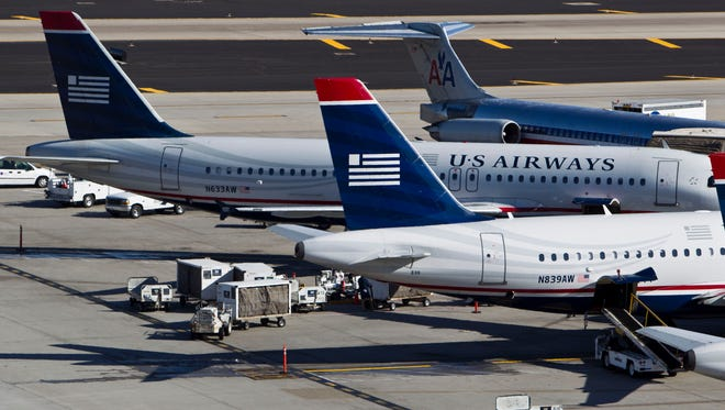 American Airlines and US Airways planes at Phoenix Sky Harbor International Airport.