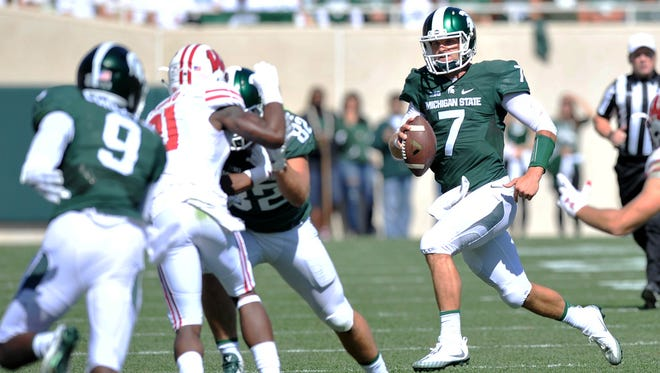 Spartan quarterback Tyler O'Connor sprints for a first down in the second quarter.