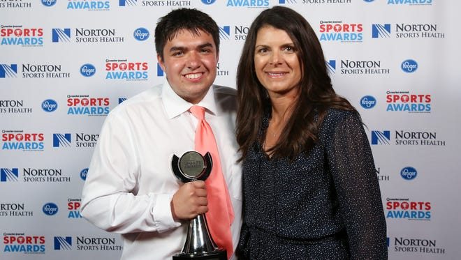 Two-time U.S. Olympic gold medalist Mia Hamm, right, posed with Dallas Derringer during the CJ Sports Awards.June 12, 2017