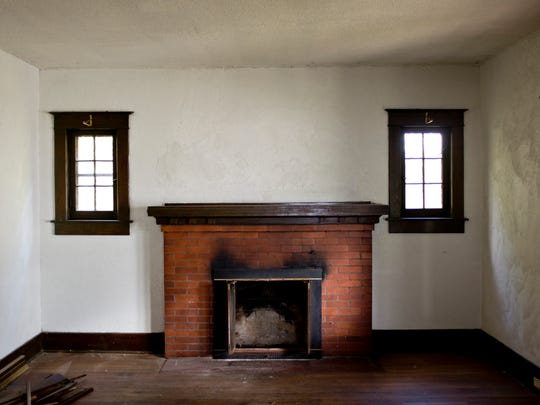A fireplace and wood accented windows are seen in the front room at 3821 Military Street in Port Huron.