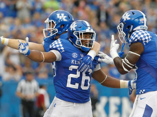 Sep 17, 2016; Lexington, KY, USA; Kentucky Wildcats running back Benny Snell Jr (26) celebrates with teammates after scoring a touchdown against the New Mexico State Aggies in the second half at Commonwealth Stadium. Kentucky defeated New Mexico State 62-42.