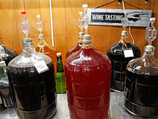 Glass carboys hold Double Daylo wine as it ferments.