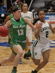 Fort Myers High School's Tatum Hayes (13) drives up