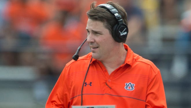 Auburn defensive coordinator Will Muschamp coaches from the sideline during the Auburn A-Day spring game on Saturday, April 18, 2015, at Jordan-Hare Stadium in Auburn, Ala.
