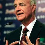 John Hart  has agreed to a three-year contract that will continue through the Braves' first season at its new stadium.