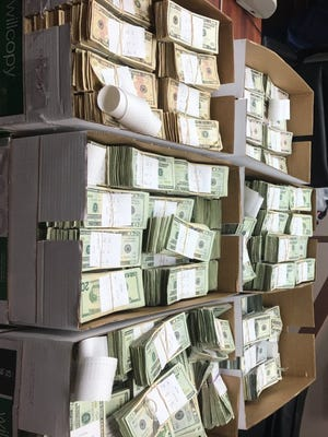 Courtesy photo   More than $1 million in cash was discovered during a traffic stop in Clay County.  Two people were arrested in what authorities suspect was a money laundering scheme connected to drugs.