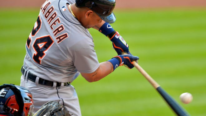 Tigers first baseman Miguel Cabrera (24) singles in the first inning of the Tigers' 8-5 win Monday in Cleveland.