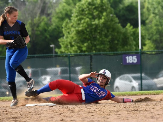 Lakewood's Tigan Braskie slides in to second base during last Wednesday's Division II regional semifinal against Warren Local at Pickerington Central. The Lancers won 10-1.