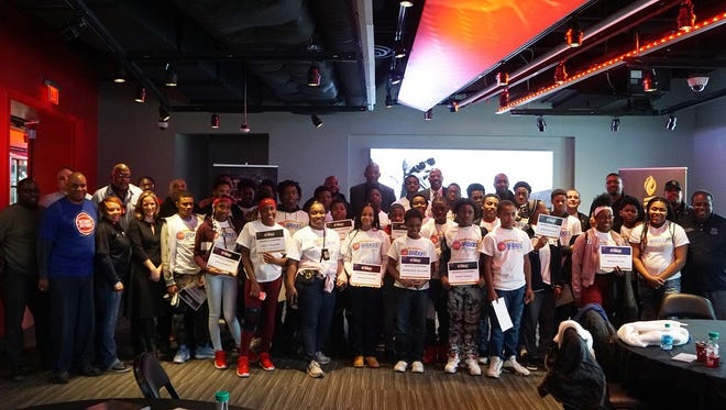 Detroit teenagers who completed the Building Bridges Through Basketball program pose for a photo after a breakfast hosted by the Pistons on Monday, Jan. 15, 2017 at Little Caesars Arena in Detroit.