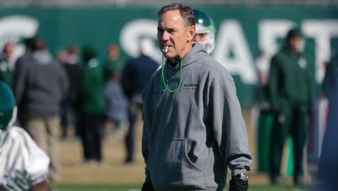 Michigan State coach Mark Dantonio watches players during the first spring practice on March 24 at the Duffy Daugherty Football Building in East Lansing.
