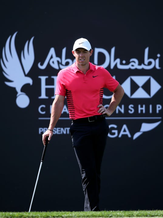FILE - In this Saturday, Jan. 20, 2018, file photo, Northern Ireland's Rory McIlroy reacts on the first hole during the third round of the Abu Dhabi Championship golf tournament in Abu Dhabi, United Arab Emirates. McIlroy makes his U.S. debut for this eyar at the AT&T Pebble Beach Pro-Am. (AP Photo/Kamran Jebreili, File)