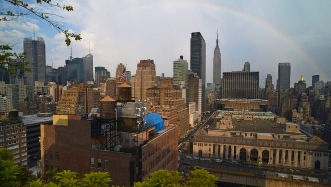 A rainbow appears in the New York skyline during a July 2013 heat wave. Scientists may have found a way to predict some killer heat waves up to three weeks in advance.