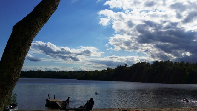 Beach goers relaxed and frolicked on June 14 at Heart Pond. The town's beaches at Heart Pond and Freeman Lake reopened June 12, after being closed and barricaded due to reported violations of coronavirus restrictions.
