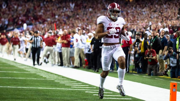 Alabama defensive back Minkah Fitzpatrick (29) scores a touchdown after an interception during the first half of the SEC Championship football game between Alabama and Florida on Saturday, Dec. 3, 2016, in Atlanta, Ga.