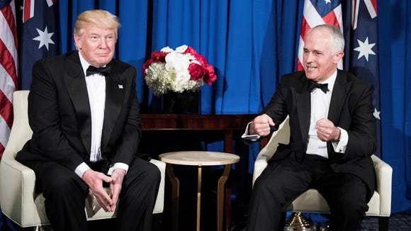 A file photo taken on May 4, 2017, shows President Donald Trump listening to Australian Prime Minister Malcolm Turnbull before a meeting on board the Intrepid Sea, Air and Space Museum in New York, New York.