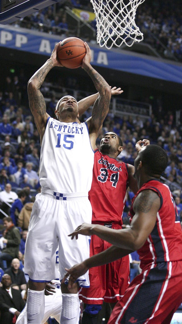 Feb 4, 2014; Lexington, KY, USA; Kentucky Wildcats forward Willie Cauley-Stein (15) shoots the ball against Mississippi Rebels forward Aaron Jones (34) in the first half at Rupp Arena. Mandatory Credit: Mark Zerof-USA TODAY Sports