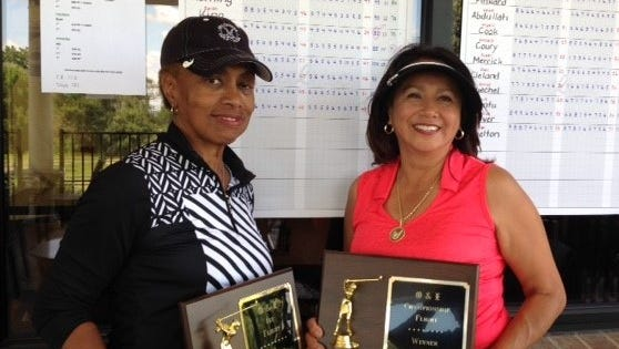 Celebrating after winning plaques at the annual Observer & Eccentric Women's Open are (left) Cynthia Pinkard, of Southfield and Olivia Bayagich, of Washington Twp. Pinkard won the First Flight while Bayagich captured the Championship Flight. The open took place at Whispering Willows Golf Course in Livonia.