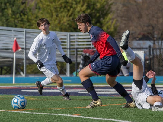 Mendham junior Calvin Ryan turns and quickly recovers