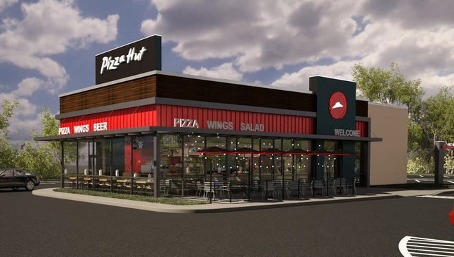 "Pizza Hut's new storefronts have the word ""beer"" featured prominently."