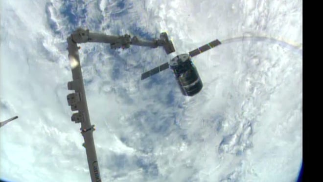 Image provided by NASA-TV shows the Cygnus spacecraft as it approaches the International Space Station on Sunday.