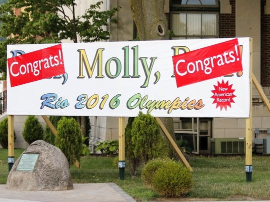 A sign in downtown Elmira updated after Molly Huddle's historic performance at the Olympic Games.