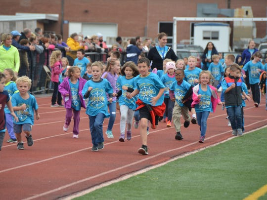 Greencastle-Antrim elementary and primary students run on the track at the annual Race for Education, on Friday, Oct. 13, at Kaley Field.
