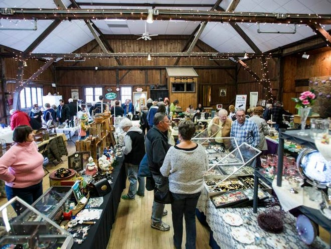 Antique collectors and enthusiasts look through antiques at the Arden Spring Fling and Collectibles Show on Sunday at the Arden Gild Hall.
