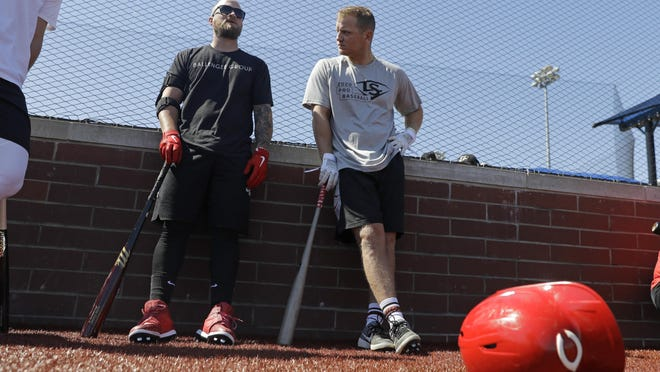 Cincinnati Reds' Tucker Barnhart, left, talks with Josh VanMeter during a workout at Grand Park, Friday, June 12, 2020, in Westfield, Ind. Proceeds from the event will go to Reviving Baseball in the Inner City of Indianapolis.